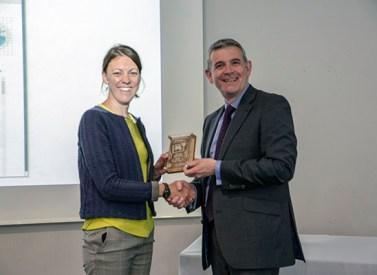 Charlotte Everitt receives her award from Prof Alex Neill
