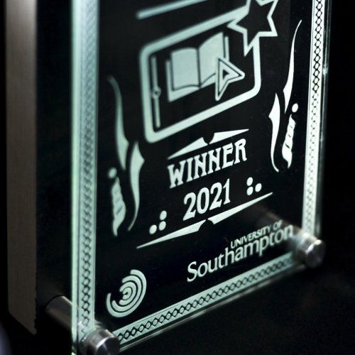 Close-up of Excellence in VLE Awards trophy with text 'Winner 2021' and 'University of Southampton'