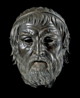 Bronze head from a statue, perhaps of Sophocles. This head represents a man of middle age, with a thick beard, slightly thinning hair and a severe expression, enhanced by a deeply wrinkled brow. His hair is bound by a rolled band, like a diadem of a type usually associated with Hellenistic rulers, rather than philosophers or playwrights © Trustees of the British Museum