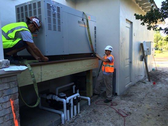 Contractors installing a generator.