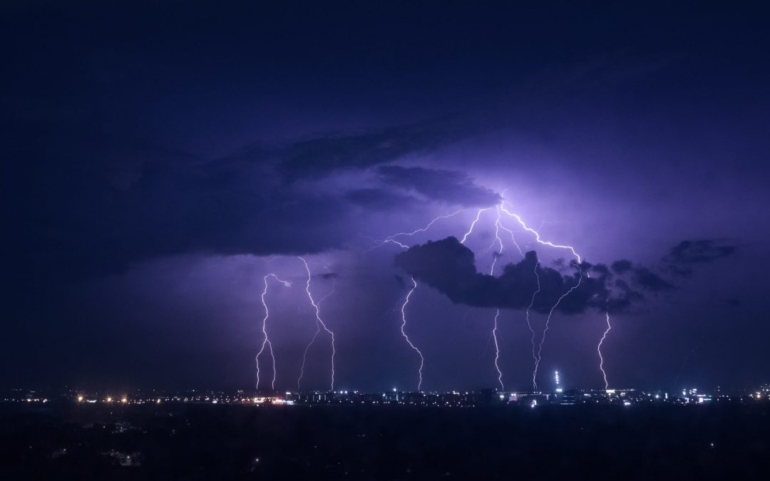 Lightning strikes city at night