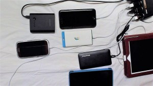 Multiple devices being charged with pedal generator