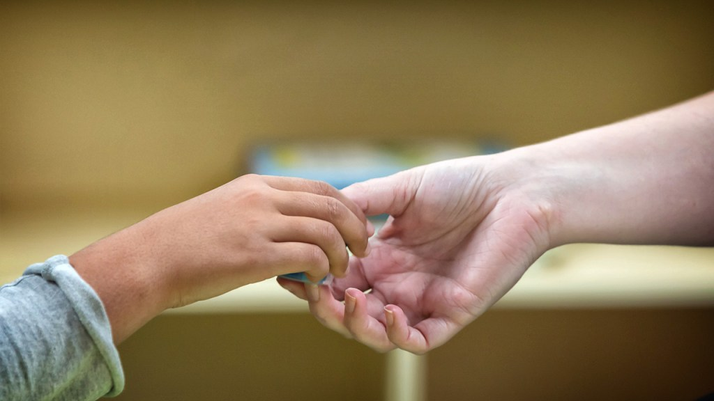 Genesis ABA Therapy Sacramento holding hands
