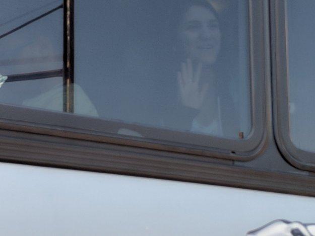 Waving Goodbye from a Bus Window