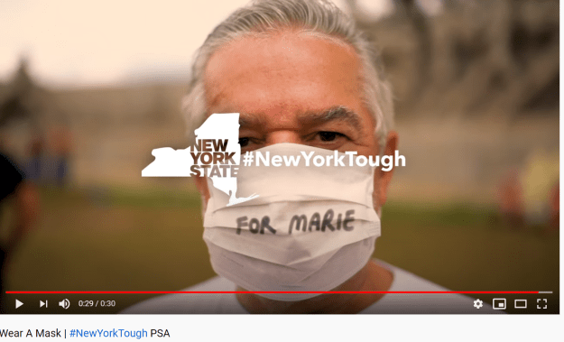 "A man wears a face mask that reads ""For Maria"" - How to Celebrate Memorial Day"
