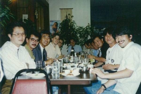 Mark Cerny (left) with various people from Sega of Japan