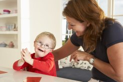 downs-syndrome-boy-having-speech-therapy_202500265