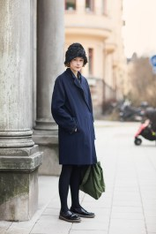 wearing coat and hat from Acne Studios, bag from Porter and shoes from Comme des Garcons