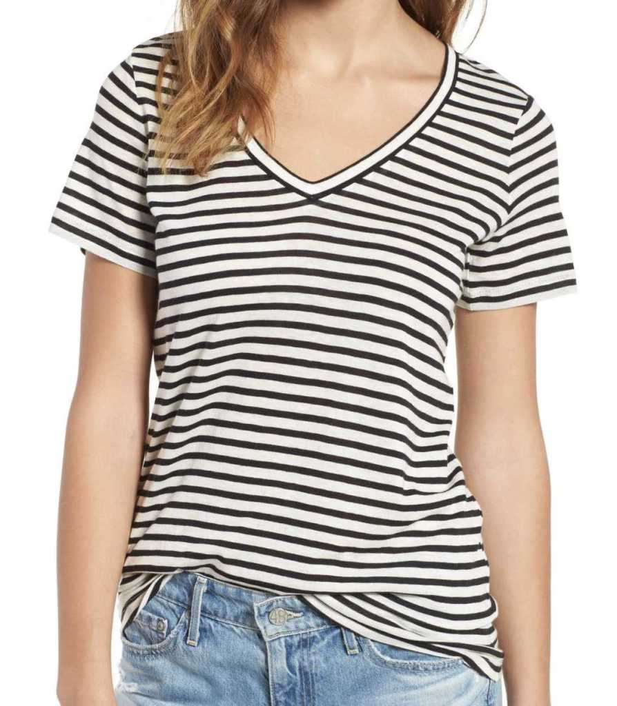 a girl wearing striped T-shirt and jeans
