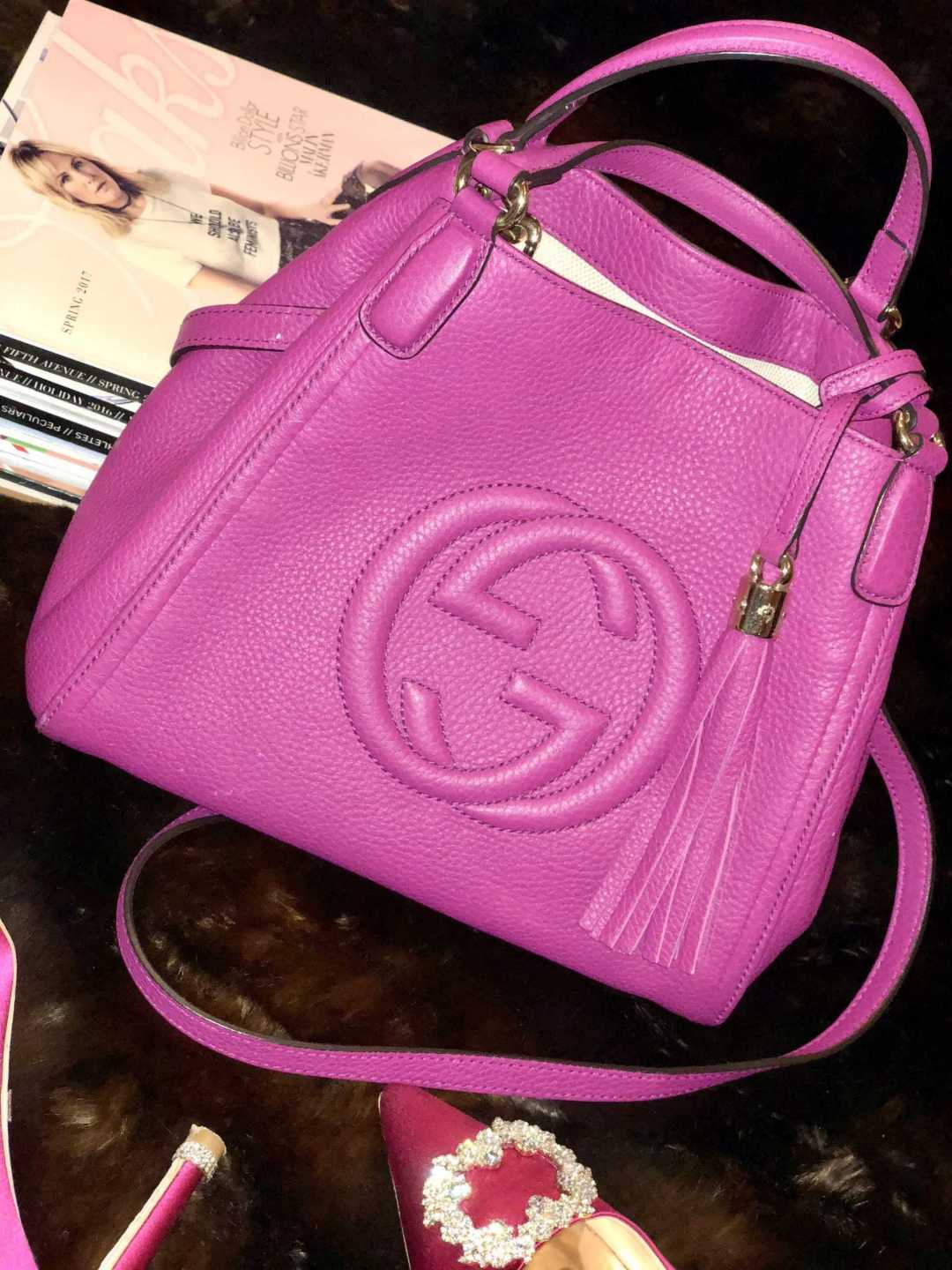A Gucci pink soho bag with fashion magazine and pink pumps