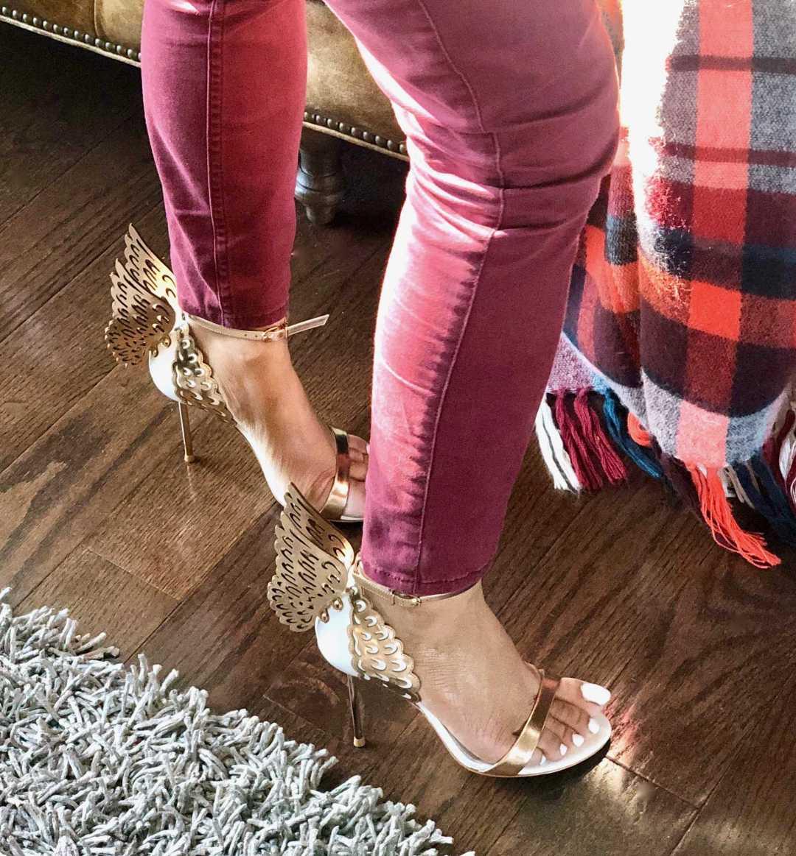 A girl showing her Sophia Webster Sandals