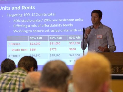 photo of man talking to group about units and rents