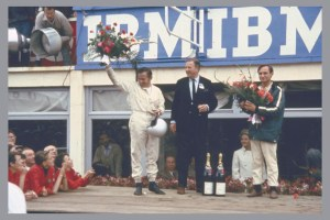 - Bruce_McLaren_Henry_Ford_II_Chris_Amon_victory_24-Hours-of-Le-Mans_1966