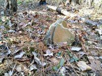 Broken stone, no markings.