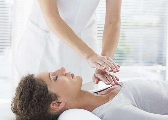 woman receiving reiki