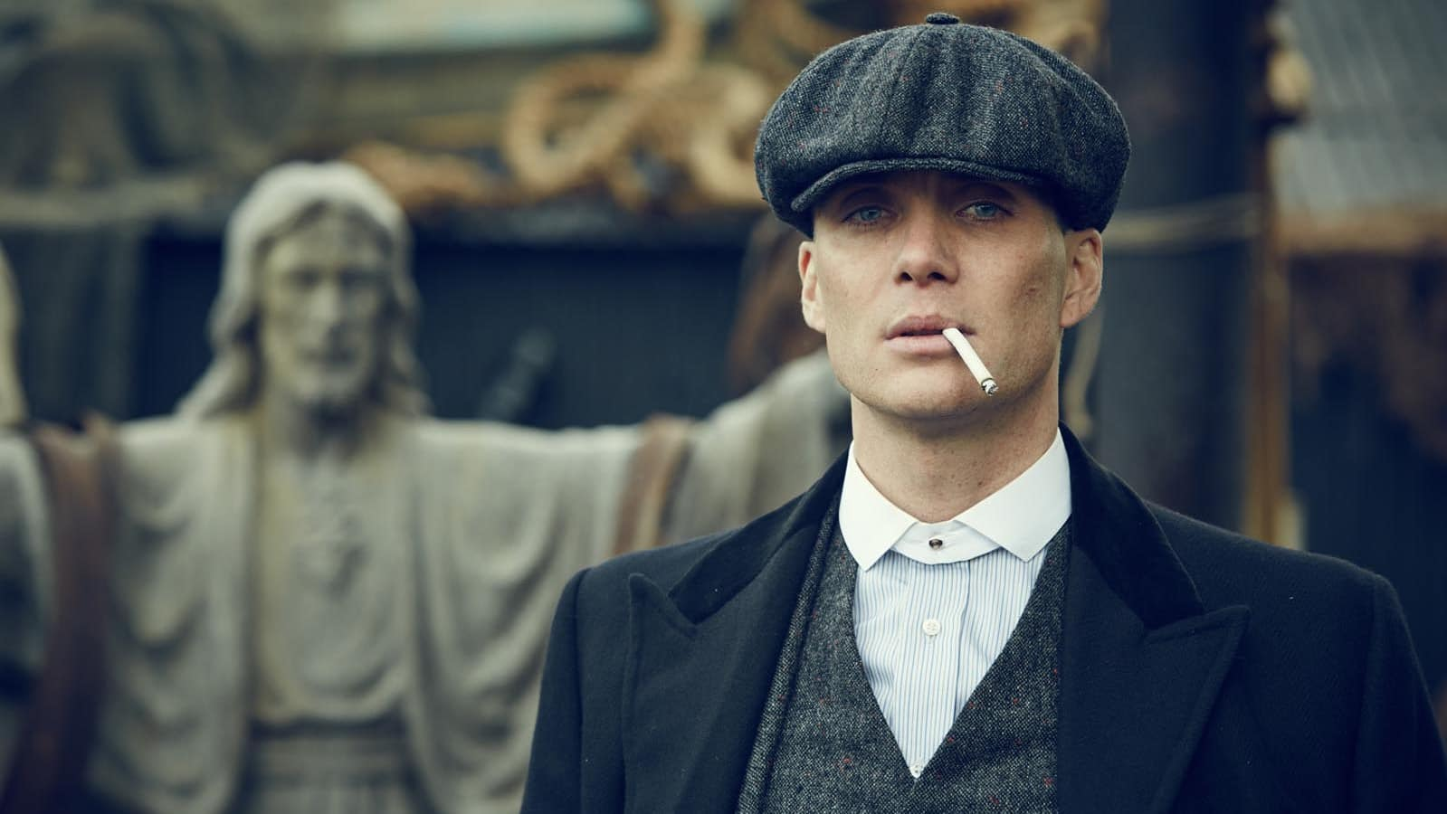 Cillian Murphy wearing a flat cap in Peaky Blinders