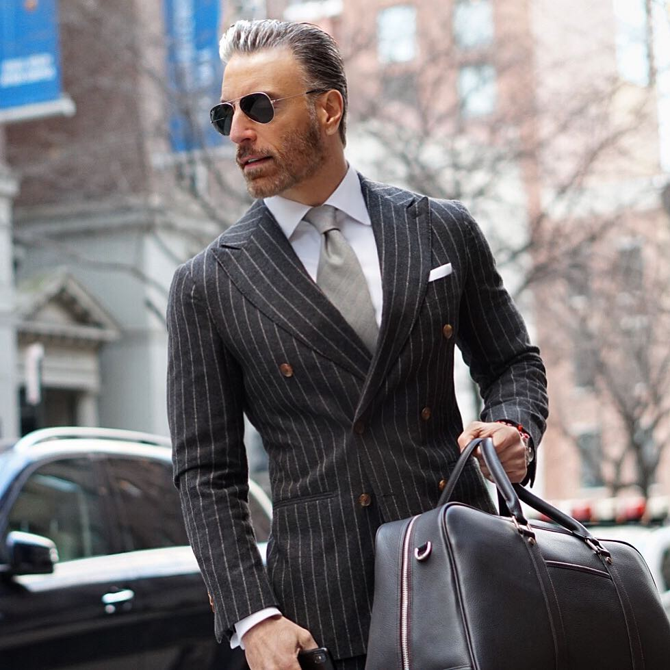 A charcoal double breasted power suit.