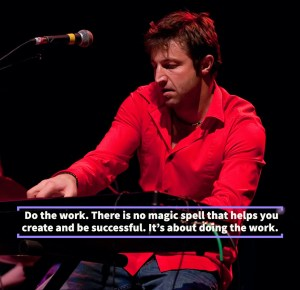 Gentry Bronson playing piano on stage