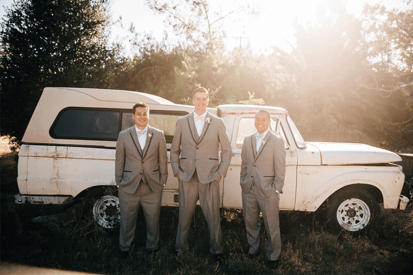 groom and groomsmen in gray tuxedos
