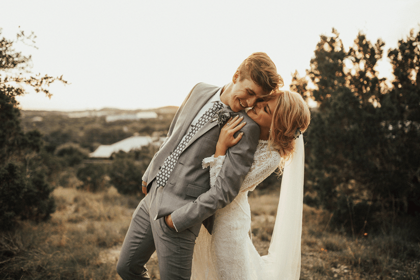bride and groom in gray suit