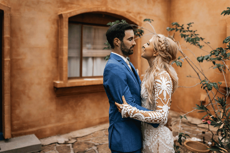 bride and groom in blue suit