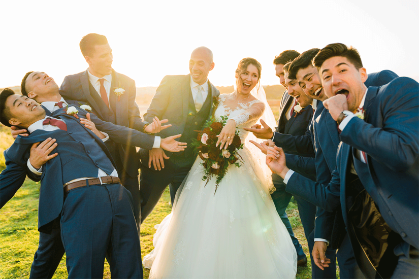 bride and groom with groomsmen in blue suits