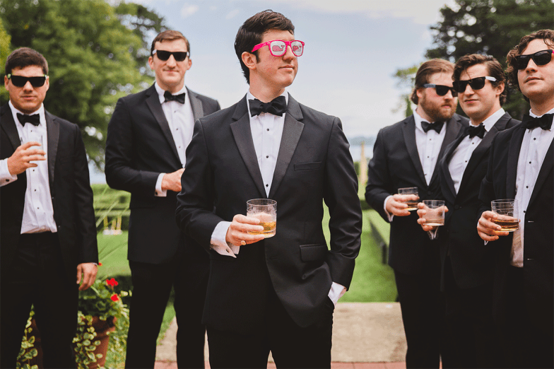 picture of groomsmen wearing funny sunglasses