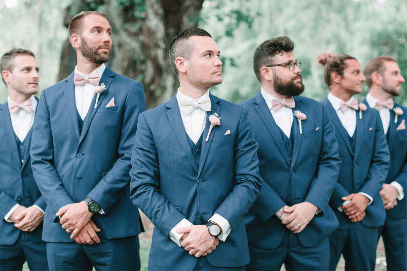 groom and groomsmen in blue suits