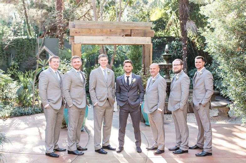 groom in gray tuxedo and groomsmen in gray suits