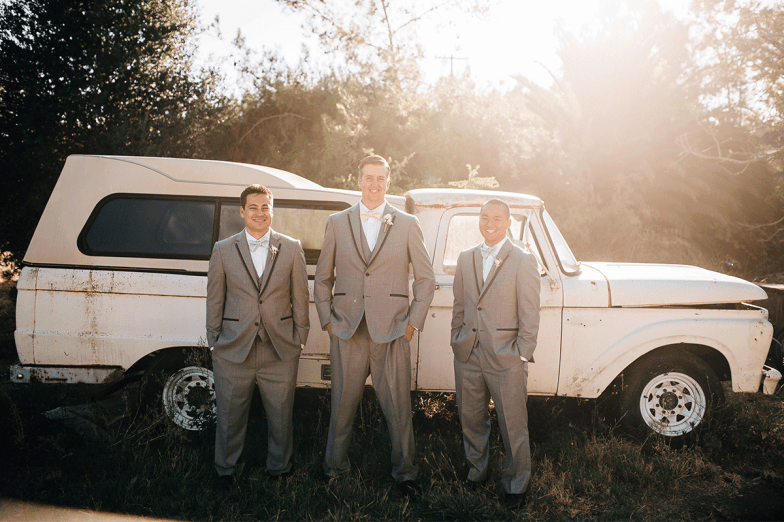 groom and groomsmen in gray tuxedos