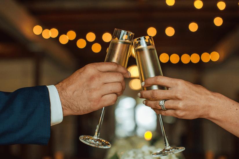 bride and groom toasting
