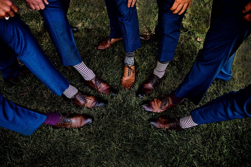 shoes and socks of groomsmen in blue suits