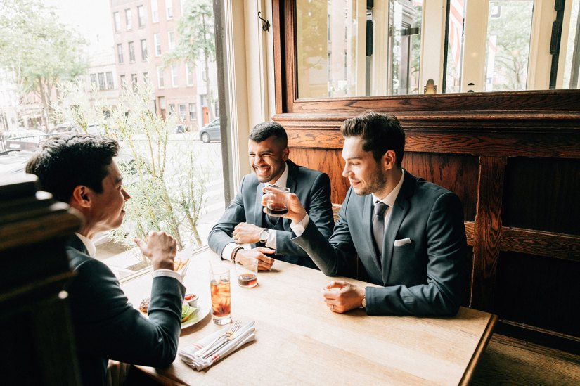 groom and groomsmen in blue suits at restaurant