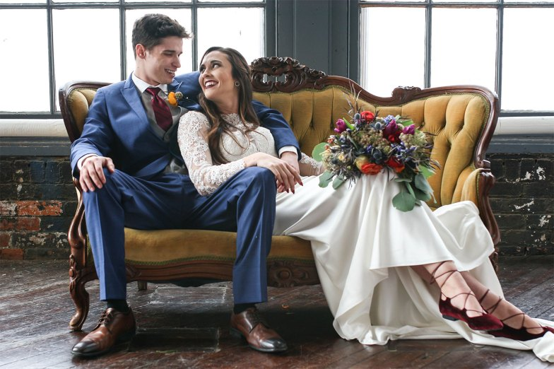 bride and groom in blue suit with bold colors