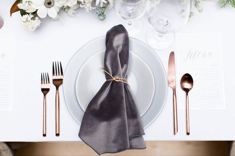 wedding reception table setting with velvet napkin