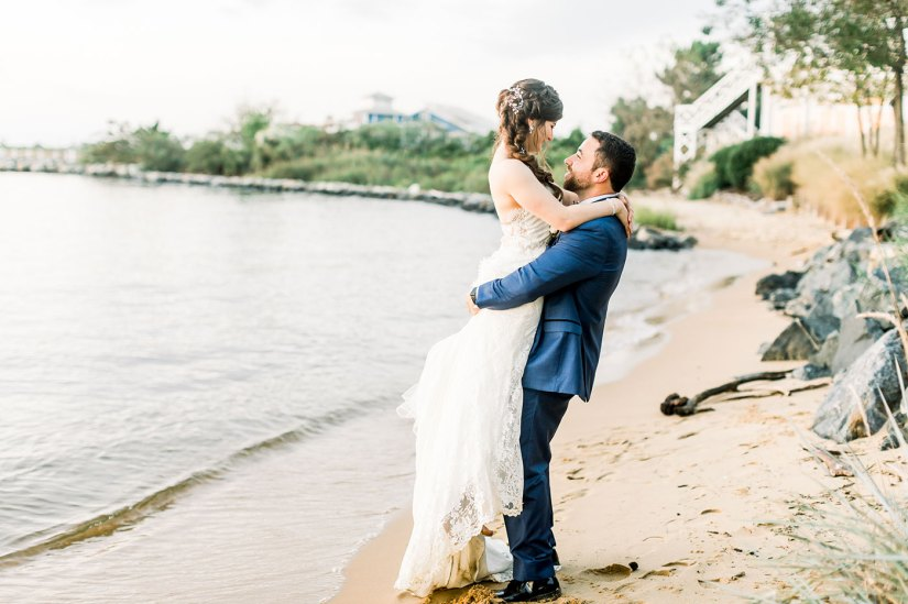 bride and groom in blue suit on beach