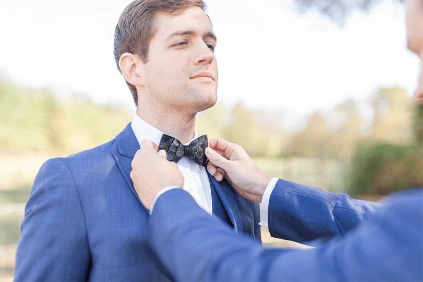 Fixing Suit Wedding Close Up Photo
