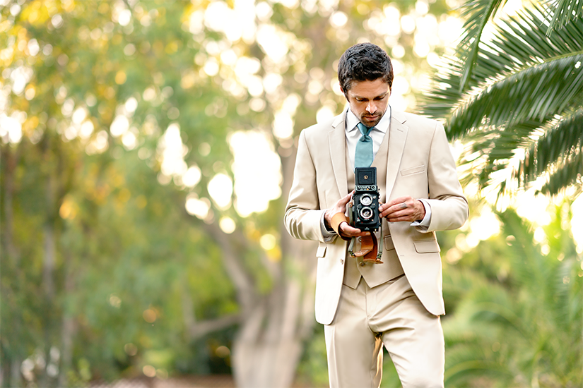Elegant Men's Tan Suit with Camera