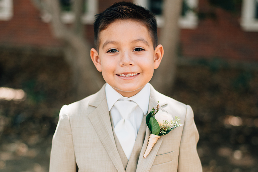 young child in youth boys dress suit