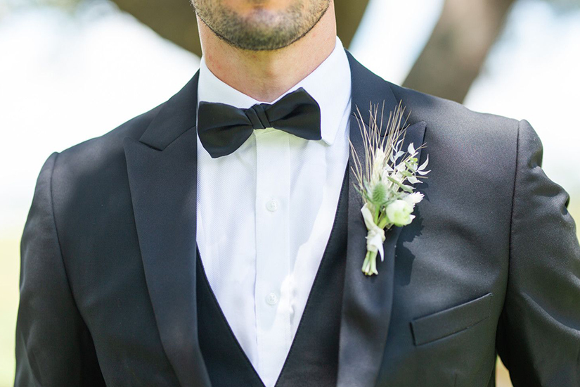 boutonniere with foliage and florals on tuxedo
