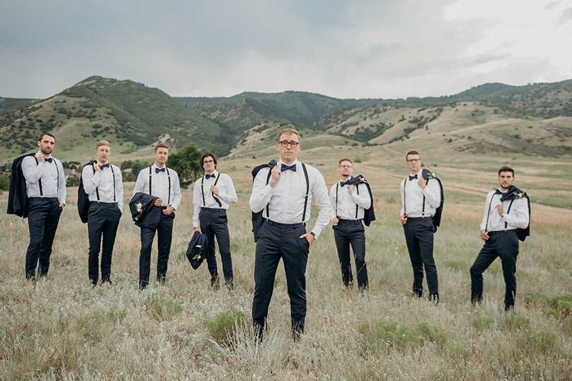 Groomsmen and groom in generation tux suspenders