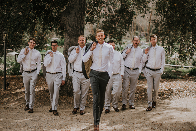 groom with groomsmen in gentux suits