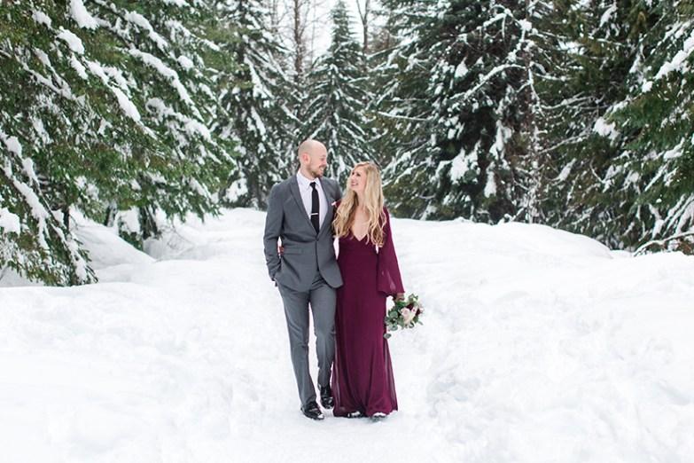 groom in gentux gray suit with bride in winter wedding