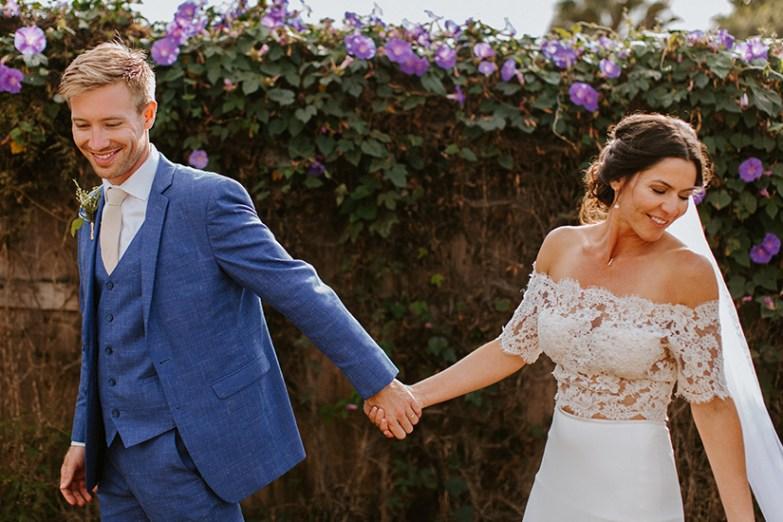 Groom in Indigo Blue Suit with bride