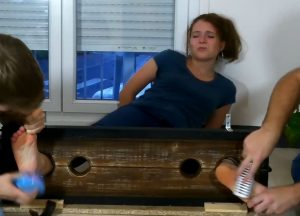 Tana is tickled on her bare feet in the stocks at genuine tickling
