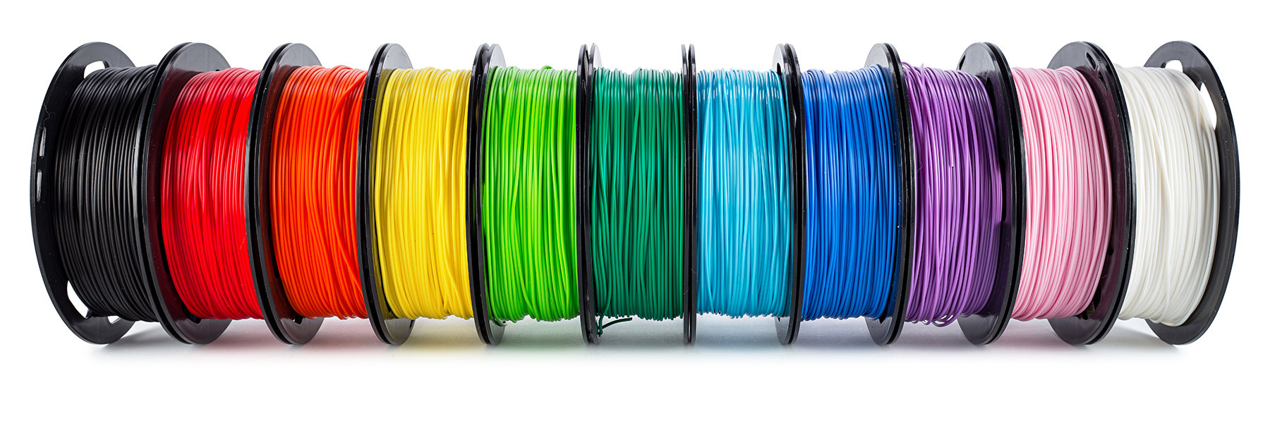 row of multi-colored 3d printer filament plastic material isolated on white background