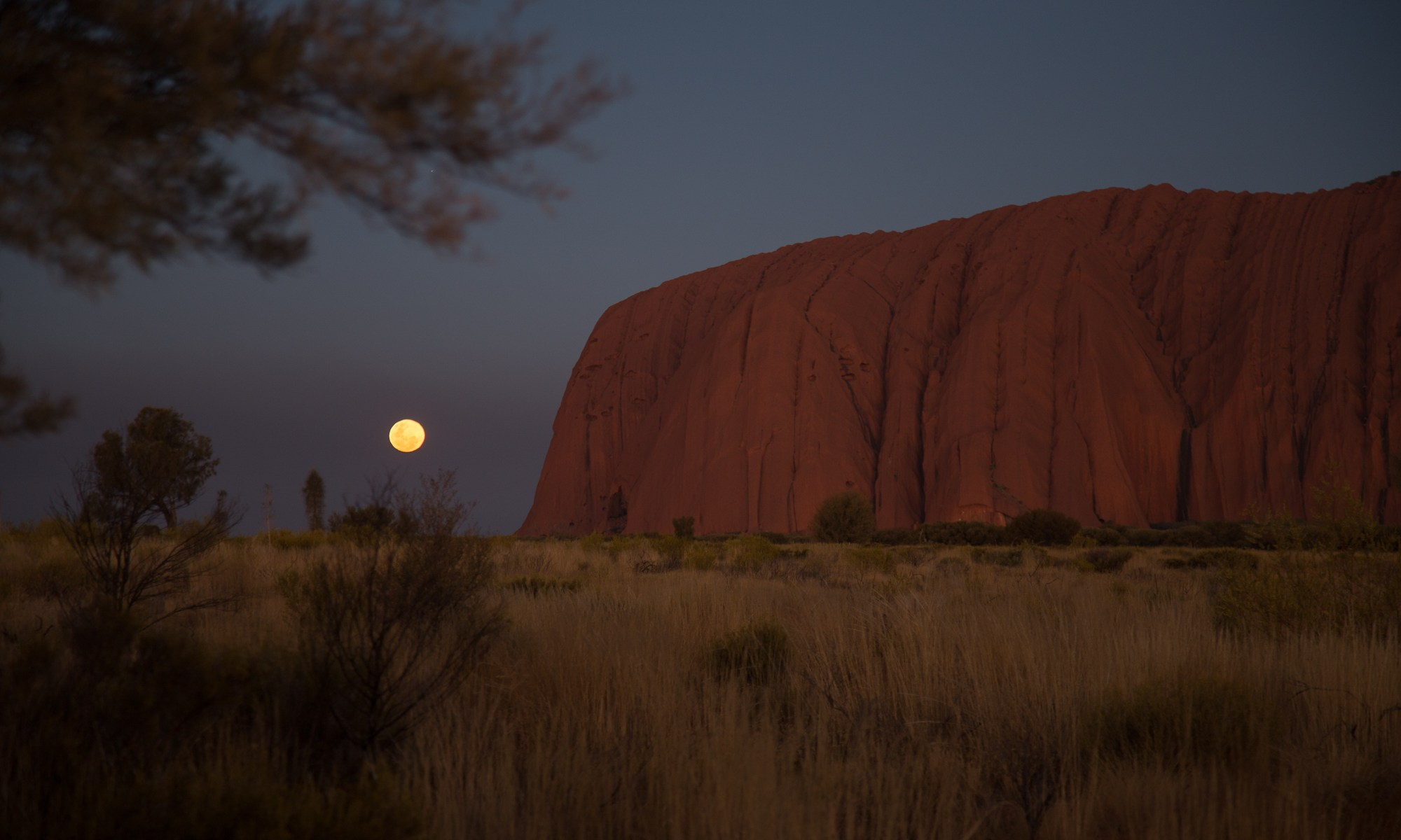 Image of the moon rising over Uluru
