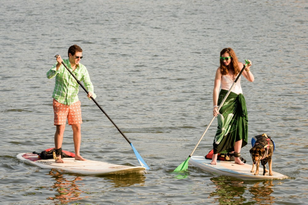 Engagement shot while paddle-boarding.