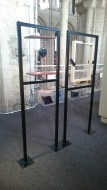 The freestanding frames for St Sebastian and Priest fixed into the gallery