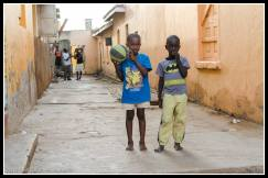 Lira boys playing ball in an alleyway